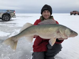 ice angler with trophy Lake Winnipeg walleye ice fishing