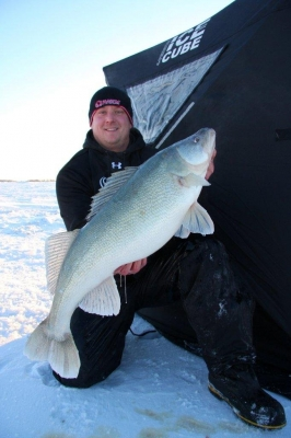 Man catches massive fish in icy terrain