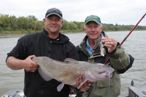 Blackwater outfitter Donovan Pearase shows off a big catch with Doug Stange in a boat