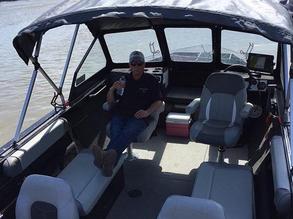 Angler relaxing in boat
