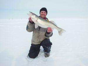 Ice fishing guide at Lake Winnipeg