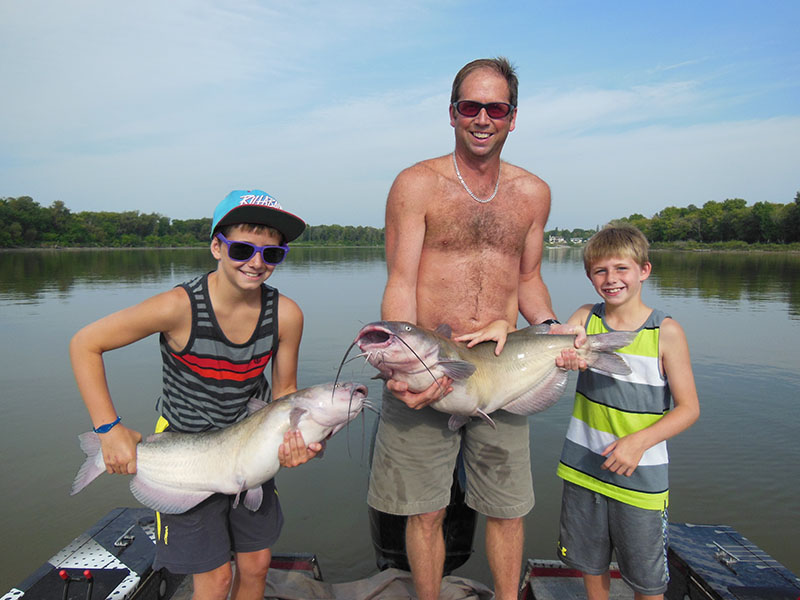 Family fishing charter with Lockport catfish Guide