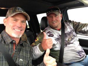 2 happy fishermen riding in a truck